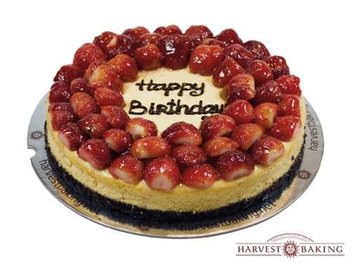 New York Cheesecake Topped with Fresh Strawberries (Seasonal)